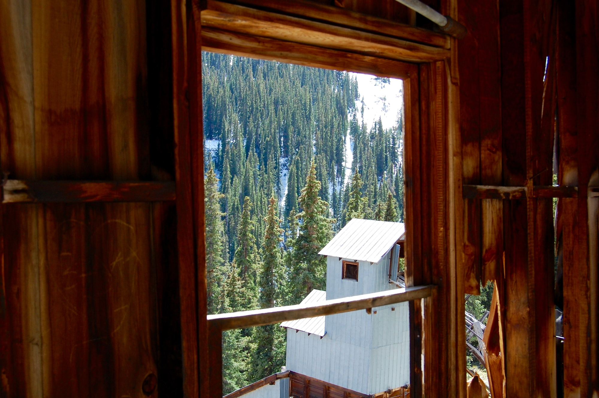 Photo of Ghost Town through another building on Engineer Pass